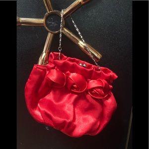 Bijoux Terner red satin rosette bag